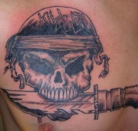 Skull with knife in teeth black  tattoo