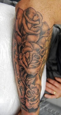 Black ink roses tattoo