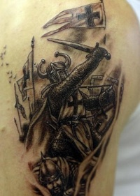 Wrathful crusader with sword tattoo